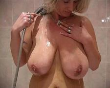 Busty MILF going solo in the bathroom
