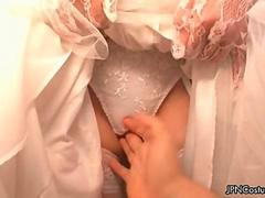 Sexy Japanese cosplay bride showing her wedding dress