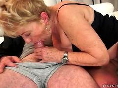 Busty granny getting fucked on the couch
