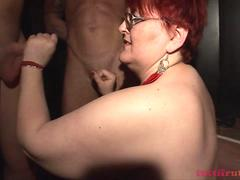 fat mature MILF in the swinger club