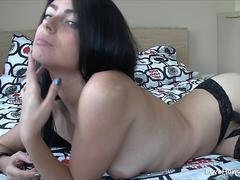 Happy dark-haired babe reveals her intimate areas