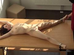 Babe is tied up and spread on the table so this creep can easy abuse her with a dildo
