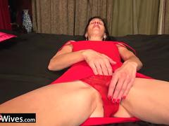 Granny in red lingerie is teasing and masturbating on her casting audition