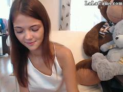 Extraordinary doll is having a good time in front of a webcam performing striptease and masturbate with fingers and toys