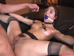 Stockinged submissive gagging during analsex