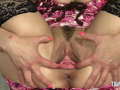 Voluptuous babe spreading her pussy