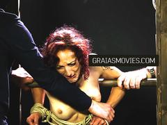 Toned redhead caned until she cries
