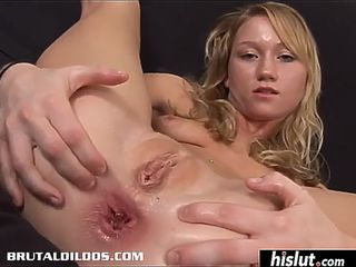 Solo model impales herself on a huge dildo