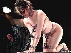 Chained young slave gets whipped