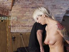 Sobbing tattooed beauty whipped on her pussy