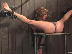 Shackled spreaded legs blonde is toyed
