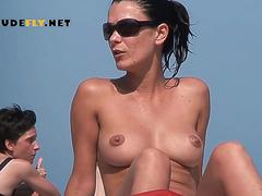 Naked girl nudist lets the water kiss her body