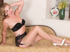 Tasty blonde Lucy Lauren frigs herself off in beige nylons suspenders leather designer heels