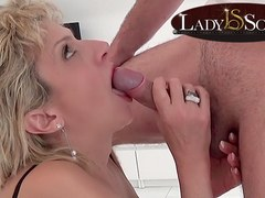 British mature Lady Sonia sucks a masked man